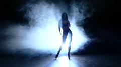 Silhouette of beautiful stripper. Slow motion. smoke Stock Footage