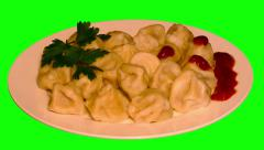 4k – Boiled meat dumplings with ketchup and parsley on plate Stock Footage