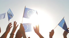 People with raised hands waving flags of the European Union. Stock Footage