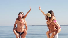 Young people having fun on the beach. Stock Footage