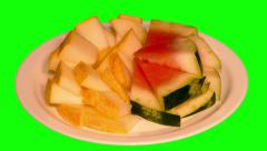 4k – Small pieces of juicy ripe watermelon and melon on plate Stock Footage