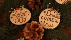 Wooden christmas ornaments with pyrography wishes Stock Footage