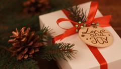 Christmas Present Box on wooden background Stock Footage