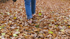 barefoot through the leaves - stock footage