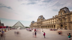 Sunny day louvre museum pyramids square panorama 4k time lapse france Stock Footage