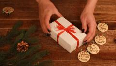 Close-up of woman tying bow on Christmas gift Stock Footage