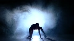 beautiful striptease dancer laying on floor, lace on face, Slow motion, smoke - stock footage