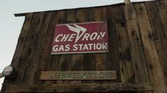 Eldorado Canyon mine tours. Old signboard Chevron gas station. Old car. Stock Footage