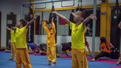 Children martial fighters training warm-up start hd china Stock Footage