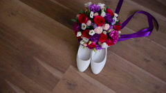 bride shoes wedding ceremony bridal bouquet flowers ribbons - stock footage