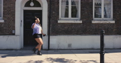 Contemporary funky African American woman street dancer dancing freestyle in the Stock Footage