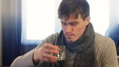 Sick man taking pill while sitting. Static shot Stock Footage