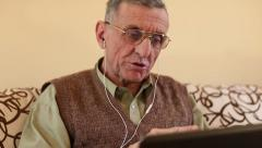 Senior man communicates via laptop. Man with notebook Stock Footage