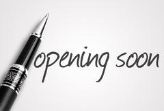 pen writes opening soon on white blank paper - stock photo