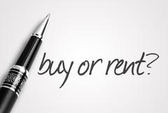 pen writes buy or rent on white blank paper - stock photo
