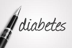 pen writes diabetes on white blank paper - stock photo