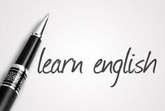 Stock Photo of pen writes learn english on white blank paper