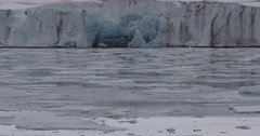 Blue Ancient Glacial Ice in Cliff at Shoreline Stock Footage