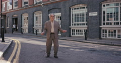 Contemporary funky elderly man street dancer dancing freestyle in the city Stock Footage