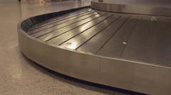 Detail of luggage carousel going around with no luggage. - stock footage