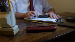 Man with hand digital calculator in his office desk Stock Footage