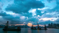 Victoria Harbour sunset view with crane ships. 4K resolution time lapse. Stock Footage