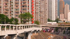 Hong Kong - Street view with footbridge and blocks of flats. 4K Stock Footage