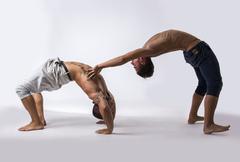 Male Acrobatic Dancers Balancing in Studio Stock Photos