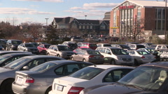 Markam pacific mall Chinese mall exteriors and parking lot full of shoppers Stock Footage