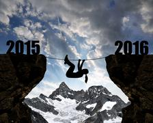 Girl climbs through the abyss into the New Year 2016 - stock photo