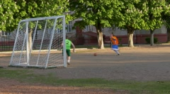 Ungraded: Amateurs Play Football on Playground Stock Footage