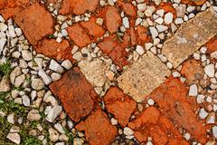 Stone rubble underfoot. Grunge background texture. - stock photo
