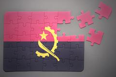 puzzle with the national flag of angola - stock photo