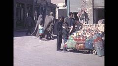 Vintage 16mm film, 1970, Iran, people market pan Stock Footage