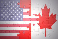 puzzle with the national flags of united states of america and canada - stock photo