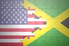 puzzle with the national flags of united states of america and jamaica - stock photo