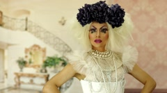 Drag queen with a glam look doing some great interacting for camera - stock footage
