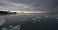 Pan of Arctic Bay with Pack Ice at Sunset Stock Footage