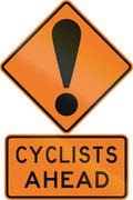 Road sign assembly in New Zealand - Cyclists ahead - stock illustration