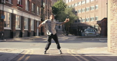 Contemporary funky mixed race man street dancer dancing freestyle in the city - stock footage