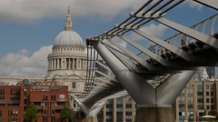 Static shot of the Millennium Bridge and St Pauls Stock Footage