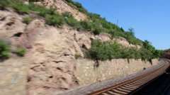 Train driving in valley Stock Footage