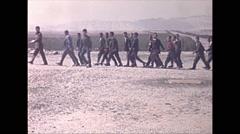 Vintage 16mm film, 1970, Iran, ruins students walking by ruins Persepolis Stock Footage