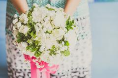 Hand holding boquet flower - stock photo