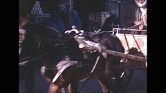Stock Video Footage of Vintage 16mm film, 1970, Afghanistan, Kabul, traffic horse and cars