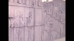 Vintage 16mm film, 1970, Iran, ruins of Persepolis students lecture Stock Footage