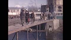 Vintage 16mm film, 1970, Afghanistan, Kabul crowded market footbridge market - stock footage