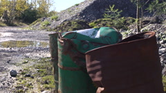 Oil drums rusting in quarry. Dolly - stock footage