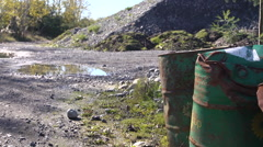 Oil drums rusting in quarry Stock Footage