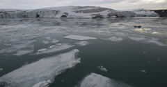 Pan from Glacier to Mountains across Icy Bay Stock Footage